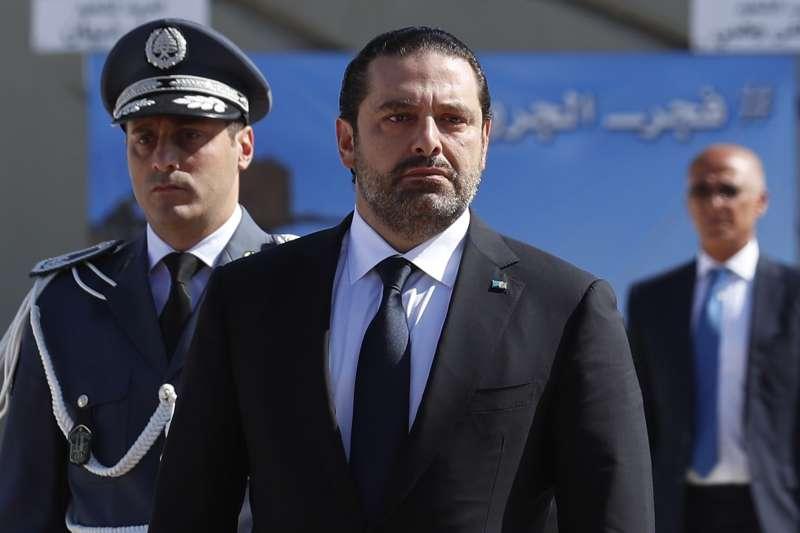 黎巴嫩總理哈里里,4日在沙烏地阿拉伯閃電辭職,圖為剛下飛機。(美聯社)