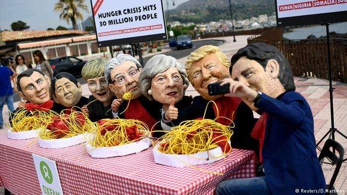 樂施會去年在義大利舉行的G7峰會期間組織舉行的抗議活動,為了讓更多人關注貧窮與飢餓人群(德國之聲)