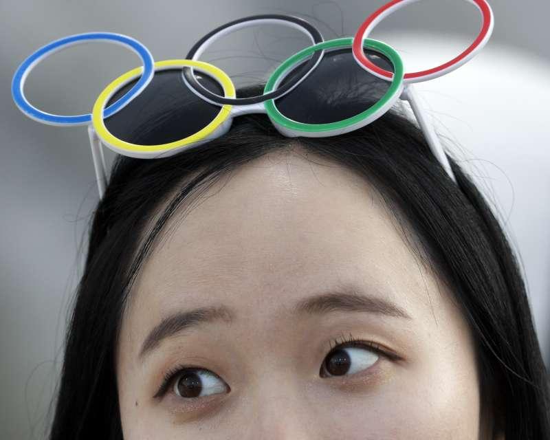 平昌冬奧南北韓展現友好氛圍,約6成民眾表達讚賞。(美聯社)