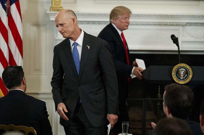 美國佛羅里達州長史考特與總統川普(AP)