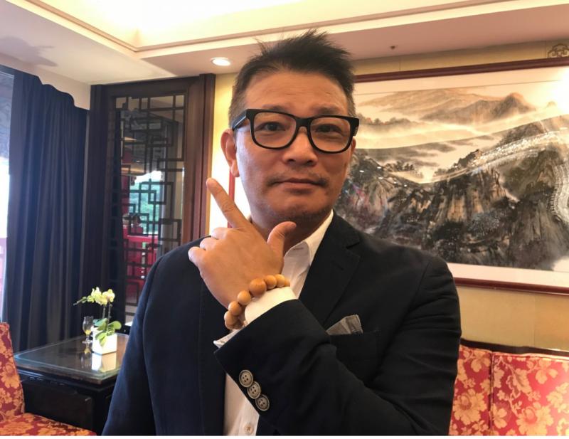 英業達事業群總經理張輝,是宏碁智慧佛珠製造的幕後推手。(圖/數位時代提供)