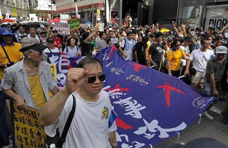2018年7月1日,香港回歸中國21周年,香港泛民團體發起七一遊行,今年遊行主題是「結束一黨專政 拒絕香港沉淪」(AP)