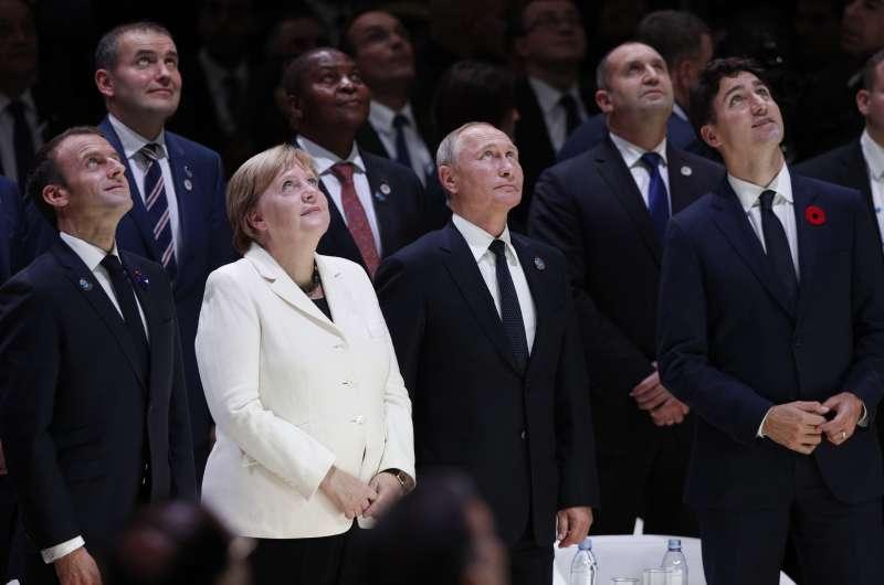 法國總統馬克宏、德國總理梅克爾、俄羅斯總統普京和加拿大總理杜魯道等領導人參與一戰終戰百年紀念儀式。(美聯社)