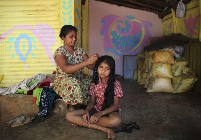 辛勤工作的印度女性。(AP)