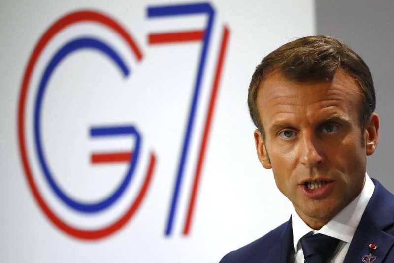 法國總統馬克宏表示不會讓巴西領導人破壞地球。(美聯社)