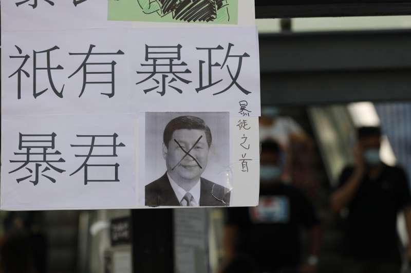 學者指出,中國對香港政策一再跳票,讓香港社會運動一再發生。(美聯社)