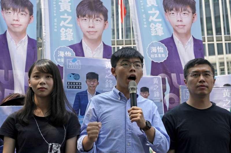 雨傘運動過後青年從街頭投入議會,卻屢屢遭打壓。(美聯社)