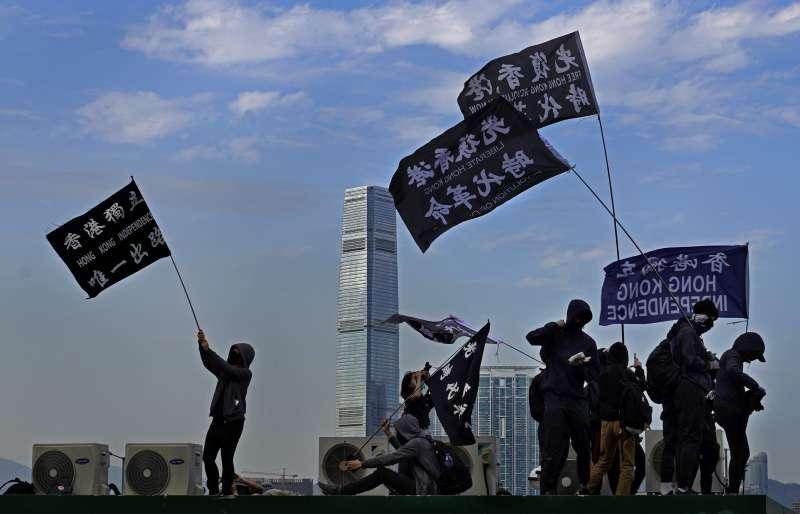 2020年1月12日,香港中環舉行「港共受刑 天下制裁」集氣大會,呼籲國際社會支持香港民主抗爭。(AP)