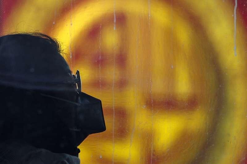 中國武漢肺炎疫情持續擴散,北京民眾人人自危(AP)