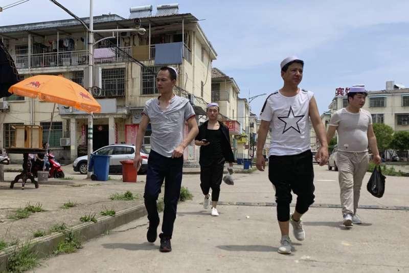 中國江西省南昌縣的歐菲光工廠遭揭露壓榨維吾爾工人,限制人身自由與信仰活動。(AP)