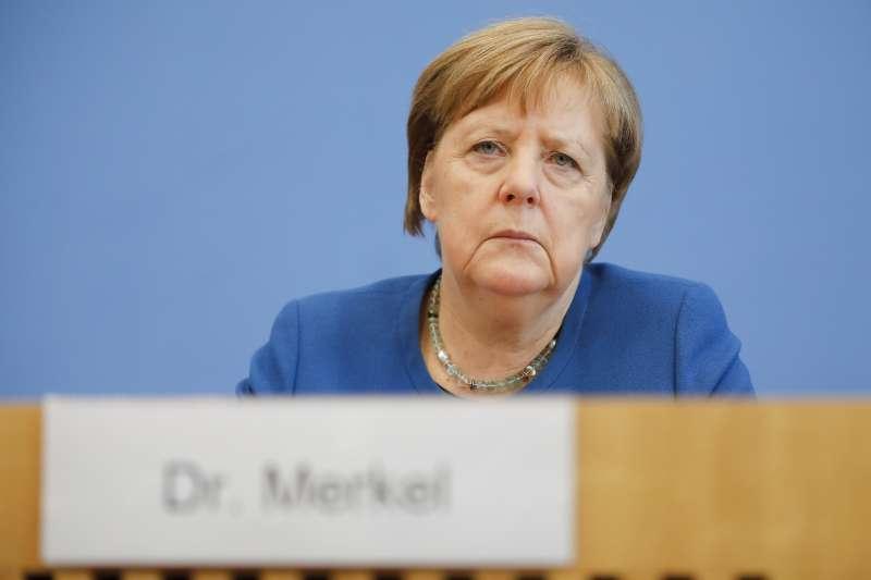 2020年3月11日,德國總理梅克爾出席首都柏林的一場武漢肺炎(新冠肺炎)疫情記者會(AP)