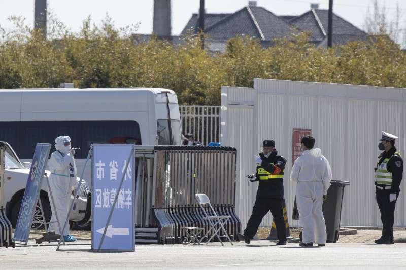 武漢肺炎:中國北京規定3月16日起,境外入京者一律隔離14天,且相關費用自付(AP)