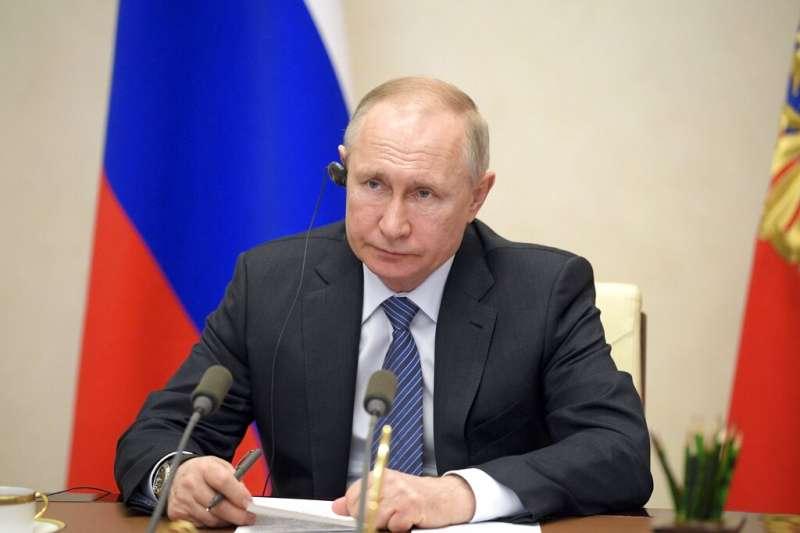 俄羅斯總統普丁(Vladimir Putin)參與首次G20視訊峰會。(AP)