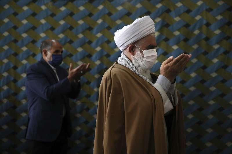 2020年7月9日,伊朗疫情嚴峻,死亡人數突破12000人。(AP)