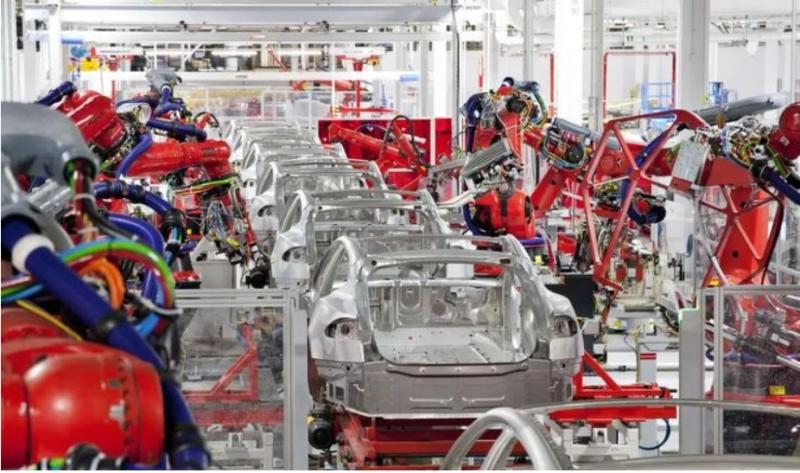 連工廠機器人都自行設計的特斯拉。(圖/方格子提供)