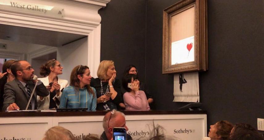 百萬英鎊名畫拍賣後自毀,班克斯謎局餘音未了